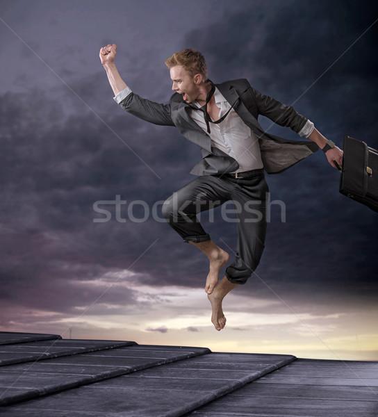 Handsome businessman celebrating a big contract Stock photo © konradbak