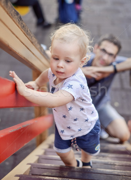 Cheerful family having fun on vacation Stock photo © konradbak