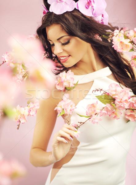 Genç bayan çiçek taç pembe çiçek Stok fotoğraf © konradbak