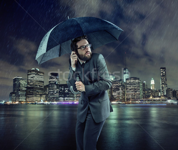 Afraid businessman in the rain Stock photo © konradbak
