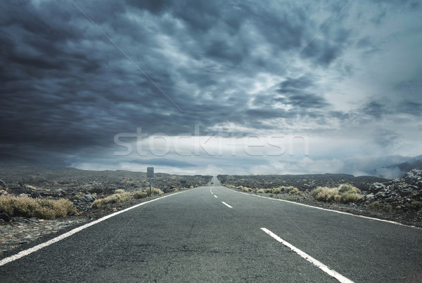 Stormy sky above the empty rural road Stock photo © konradbak