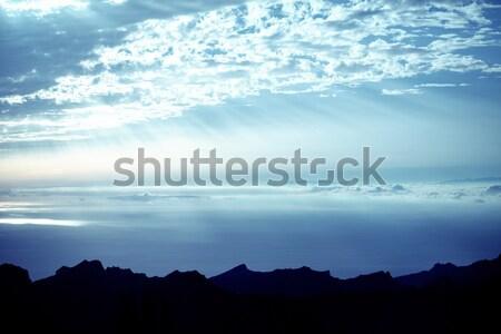 Pretty view of the sun beams among the clouds Stock photo © konradbak