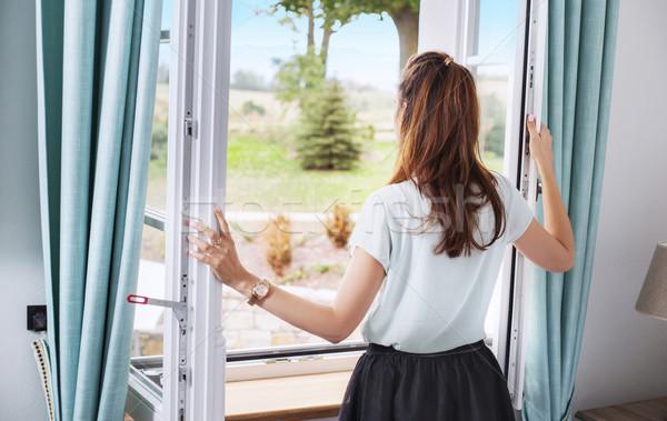 элегантный Lady открытие спальня окна женщину Сток-фото © konradbak