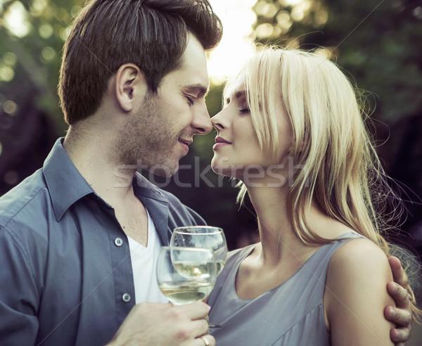 Momento romántica beso fecha vino hombre Foto stock © konradbak