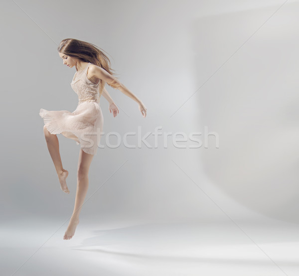 Talented young jumping ballet dancer  Stock photo © konradbak