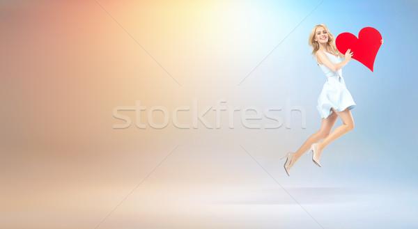 Agradável quadro voador mulher coração brinquedo Foto stock © konradbak