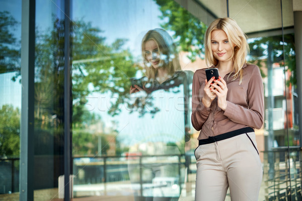 charming girl holding a new generation cell phone Stock photo © konradbak