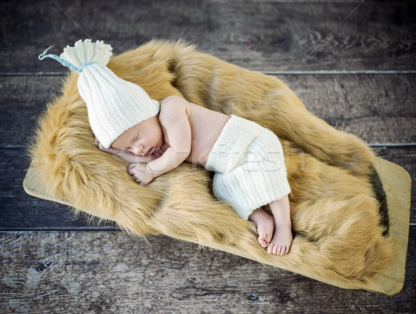 Cute little, newborn child sleeping on the soft blanket Stock photo © konradbak