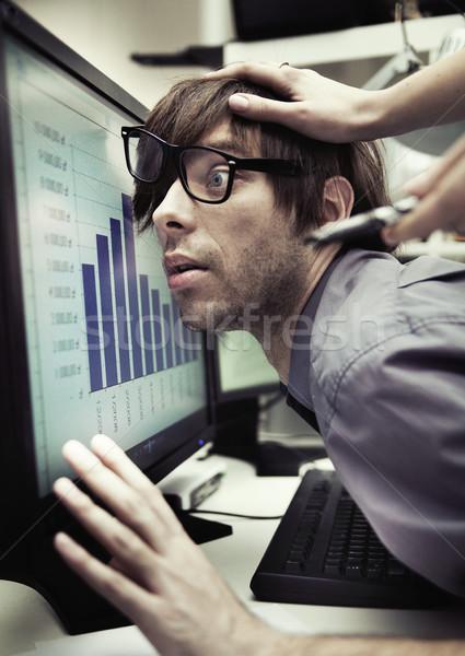 Office worker forced to work harder Stock photo © konradbak