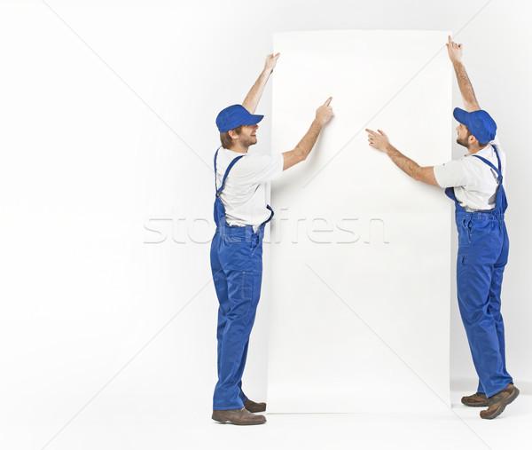 Two builders planning the renovation Stock photo © konradbak