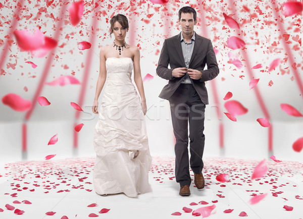 Wedding couple walking in roses  Stock photo © konradbak