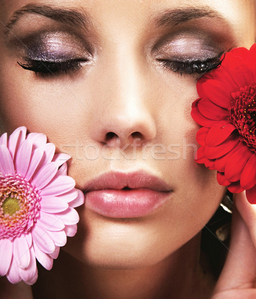 Beauty brunette with flowers Stock photo © konradbak