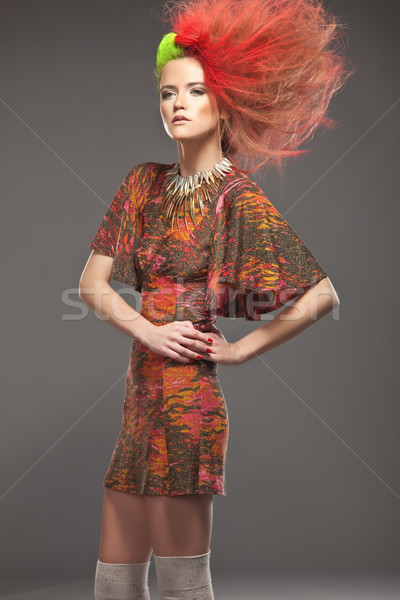 Color haired woman wearing red dress Stock photo © konradbak