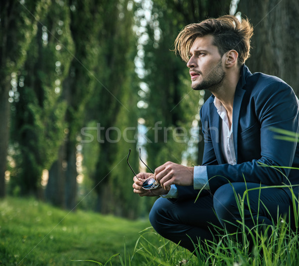 Young, calm man enjoying the summer time  Stock photo © konradbak