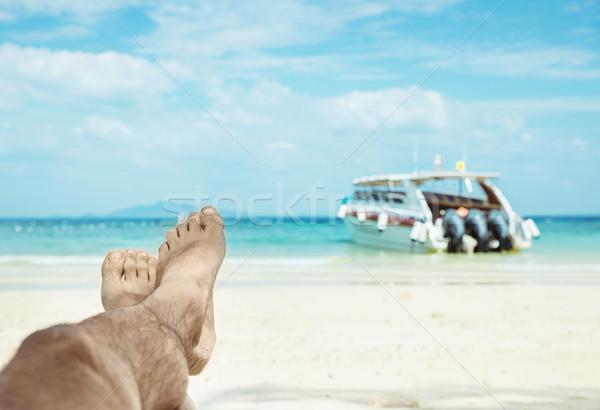 Conceptual picture of relaxing person on an asian beach Stock photo © konradbak