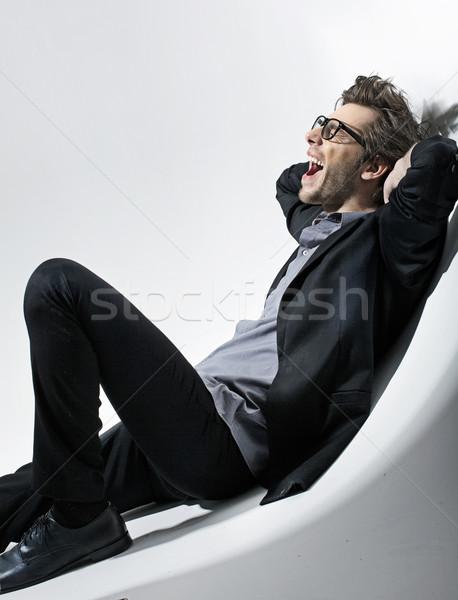 фотография сидящий молодые моде человека модель Сток-фото © konradbak