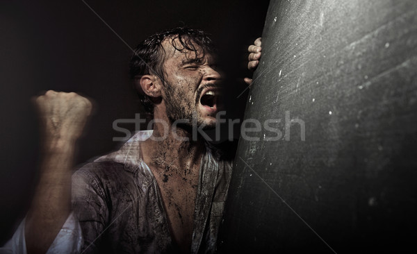 Stock photo: Dirtyand handsome man in despair