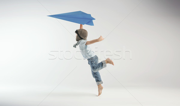 Little pilot playing paper plane Stock photo © konradbak