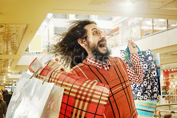 Funny guy on a shopping trip Stock photo © konradbak