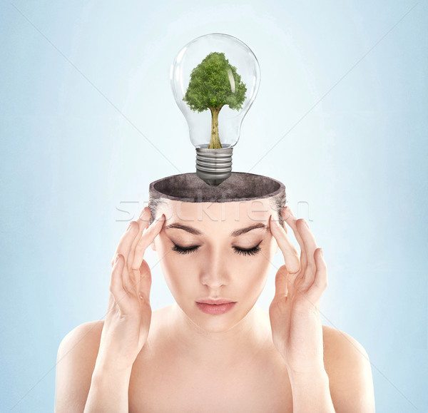 Open minded woman with green energy symbol Stock photo © konradbak