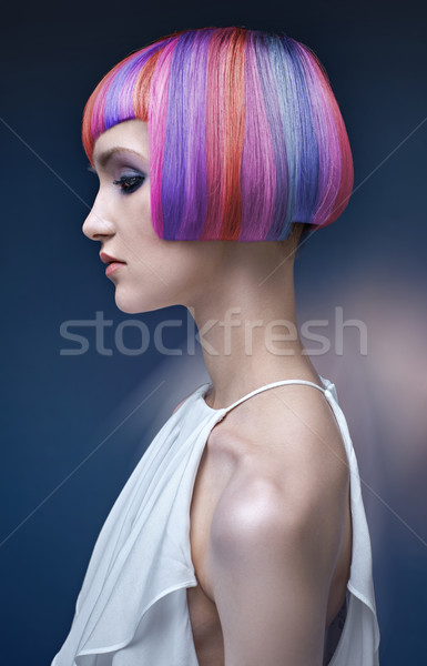 Portrait of a young lady with a colorful coiffure Stock photo © konradbak