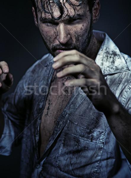 Dirty handsome man prepareing to fight Stock photo © konradbak