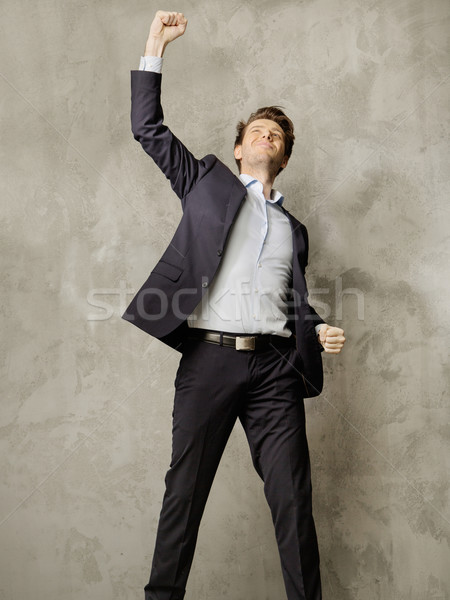 Succesful young manager presenting the victory gesture Stock photo © konradbak