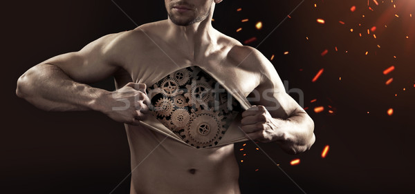 Human robot tearing up his chest skin Stock photo © konradbak