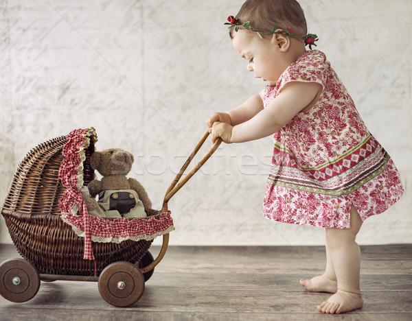 Kislány játszik játék fuvar kicsi aranyos Stock fotó © konradbak