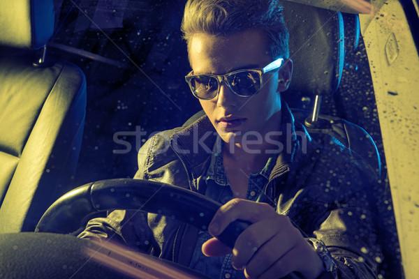 Handsome man holding a steering wheel Stock photo © konradbak