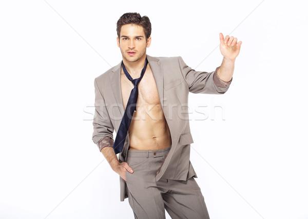 Curious stylish man wearing suit Stock photo © konradbak