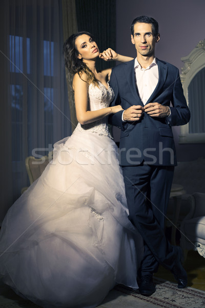 Portrait of attractive wedding couple Stock photo © konradbak