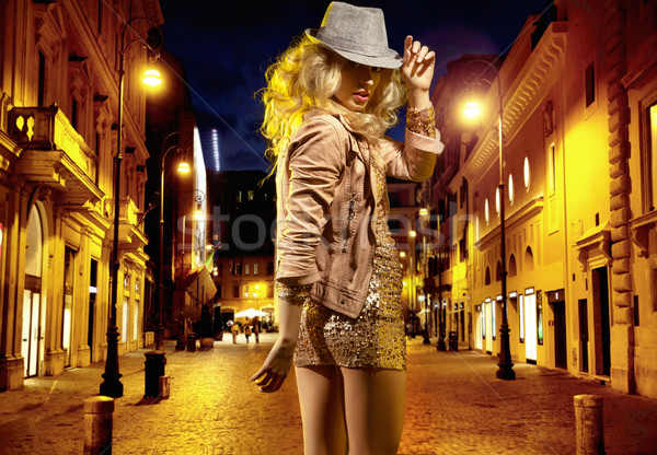 Young shapely girl heading for night club Stock photo © konradbak