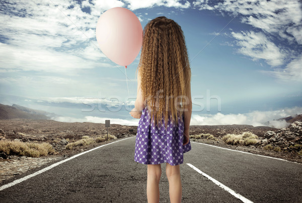 conceptual picture of a girl with a ballon Stock photo © konradbak