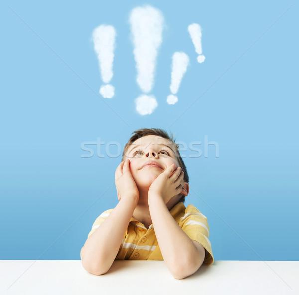 Boy with exclamation marks above head Stock photo © konradbak