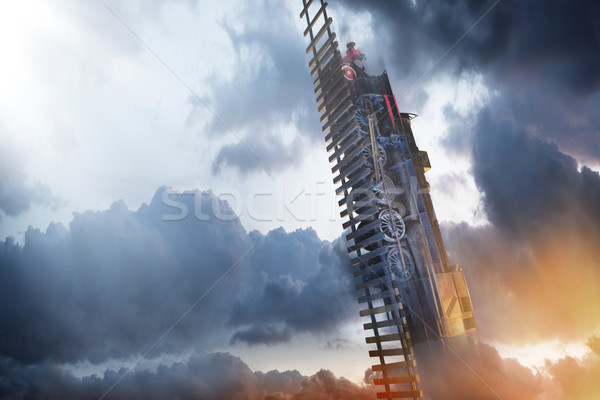 Conceptual photo of a train to the sky Stock photo © konradbak