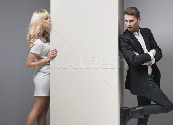 Alluring blonde woman trying to catch her boyfriend Stock photo © konradbak