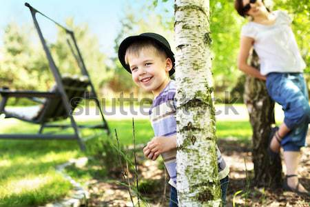 Photo of small kid trying to escape with suitcase Stock photo © konradbak