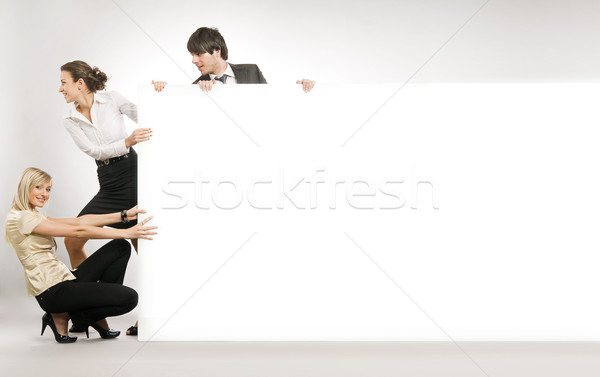 Business people pushing big white board, lots of copyspace Stock photo © konradbak