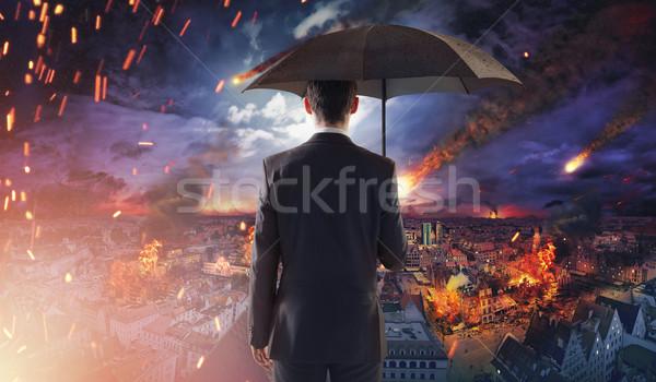 Concept of market or ecology disaster with falling meteorites Stock photo © konradbak
