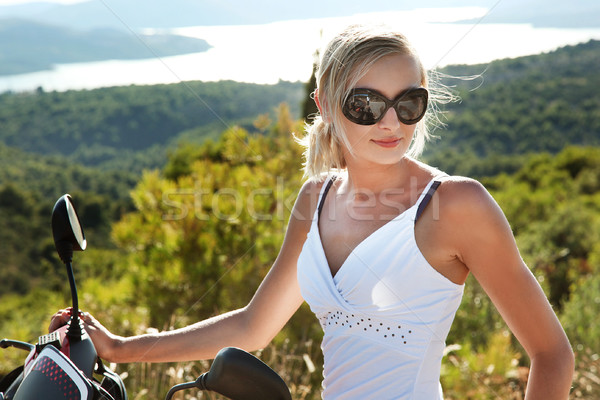 Beautiful young blonde enjoying the sunset at the seaside Stock photo © konradbak