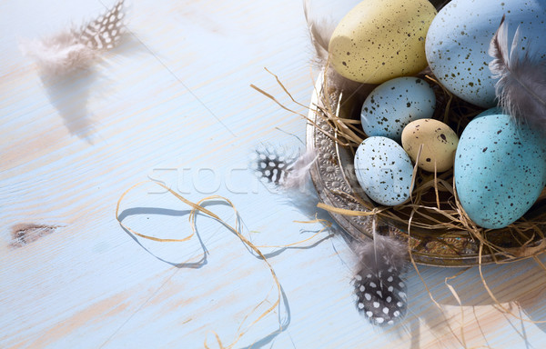 art Easter background with Easter eggs on blue table Stock photo © Konstanttin