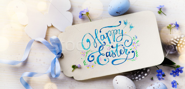 Easter card; Easter eggs and spring flovers on wood background  Stock photo © Konstanttin