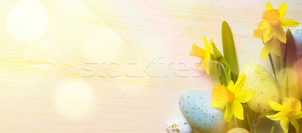 art Easter Background with easter eggs and yellow spring flowers Stock photo © Konstanttin