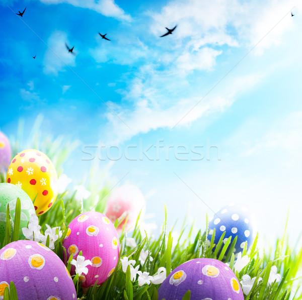 Art Easter eggs decorated with flowers in the grass on blue sky  Stock photo © Konstanttin