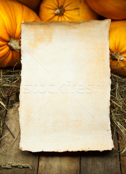 art orange pumpkins and  paper sheet  on wooden background Stock photo © Konstanttin