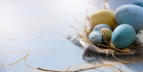 Happy Easter; Easter eggs on blue table background. Holidays vie Stock photo © Konstanttin