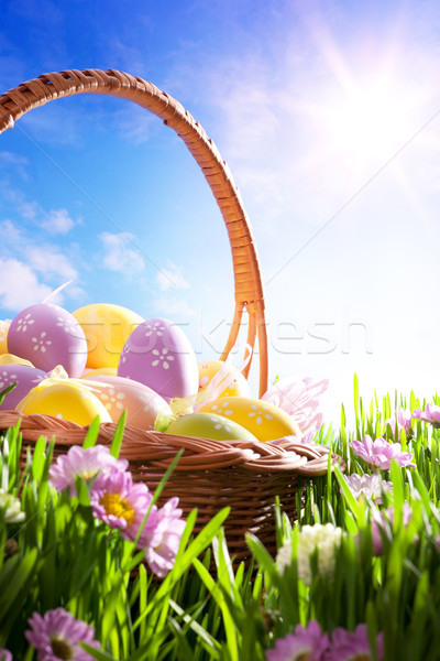 art Easter basket with Easter eggs on spring lawn Stock photo © Konstanttin