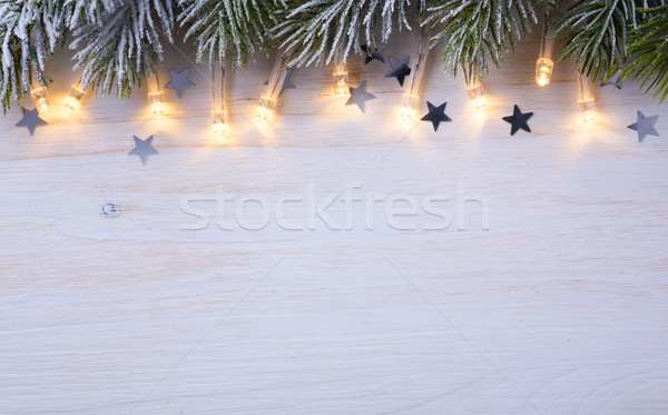 Art Christmas tree light; Christmas Background With Frost Fir Br Stock photo © Konstanttin