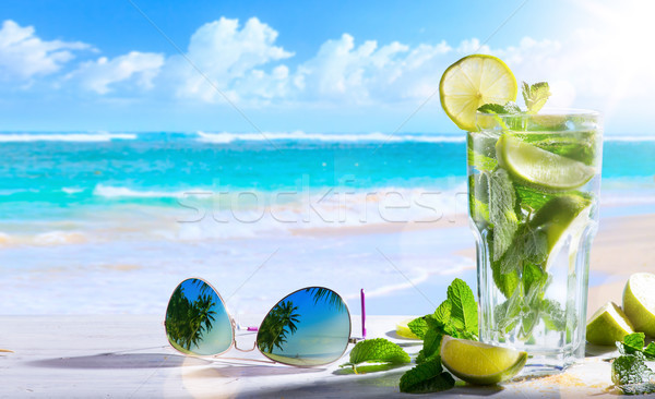 Art summer vacation; Exotic tropic drinks on blur tropical beac Stock photo © Konstanttin